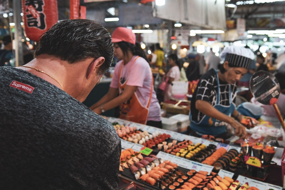man selecting food on store