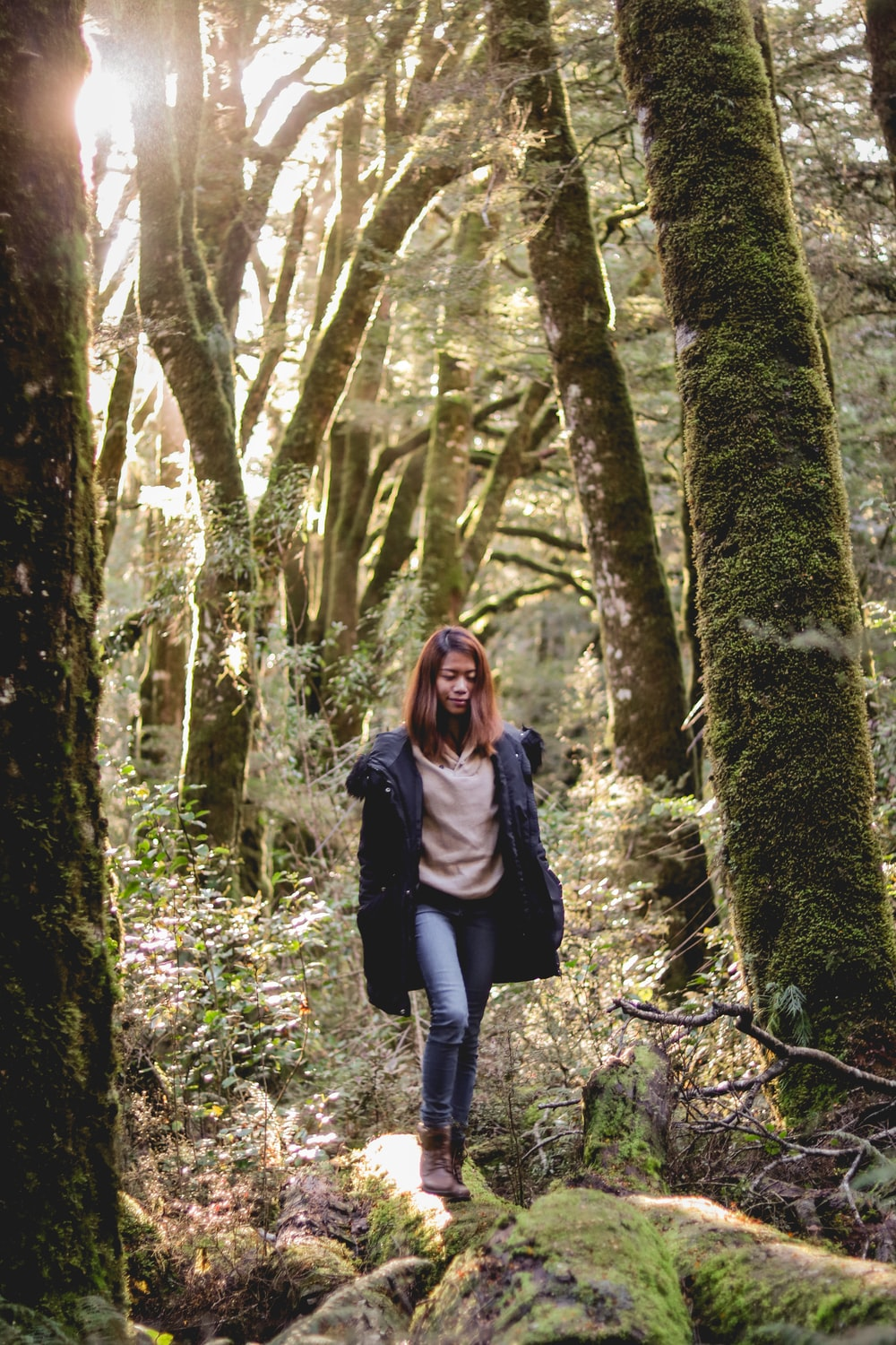 woman surrounded by trees