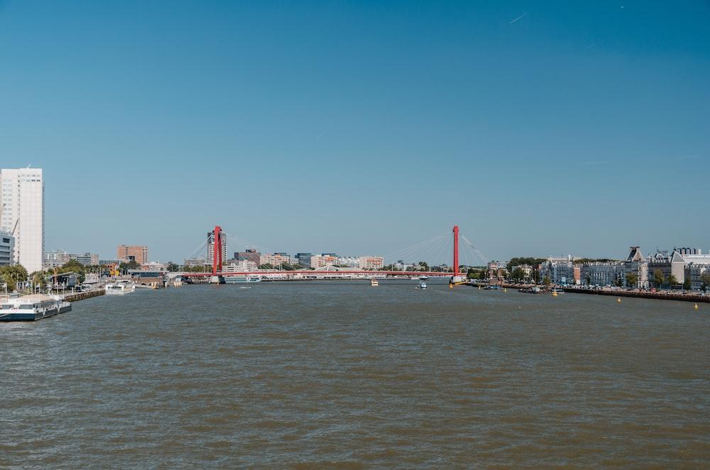 red bridge under clear blue sky