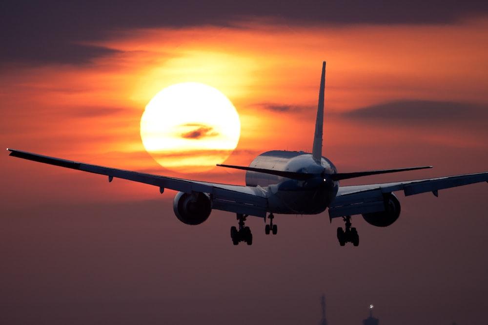 white plane flying during golden hour