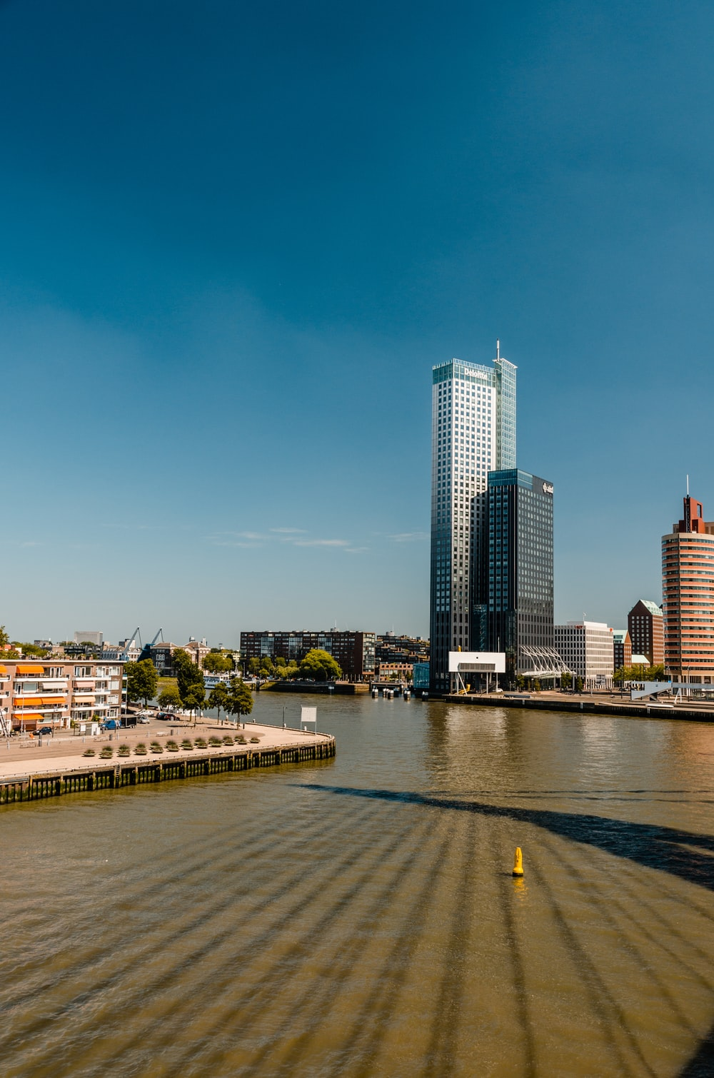 river and buildings during day
