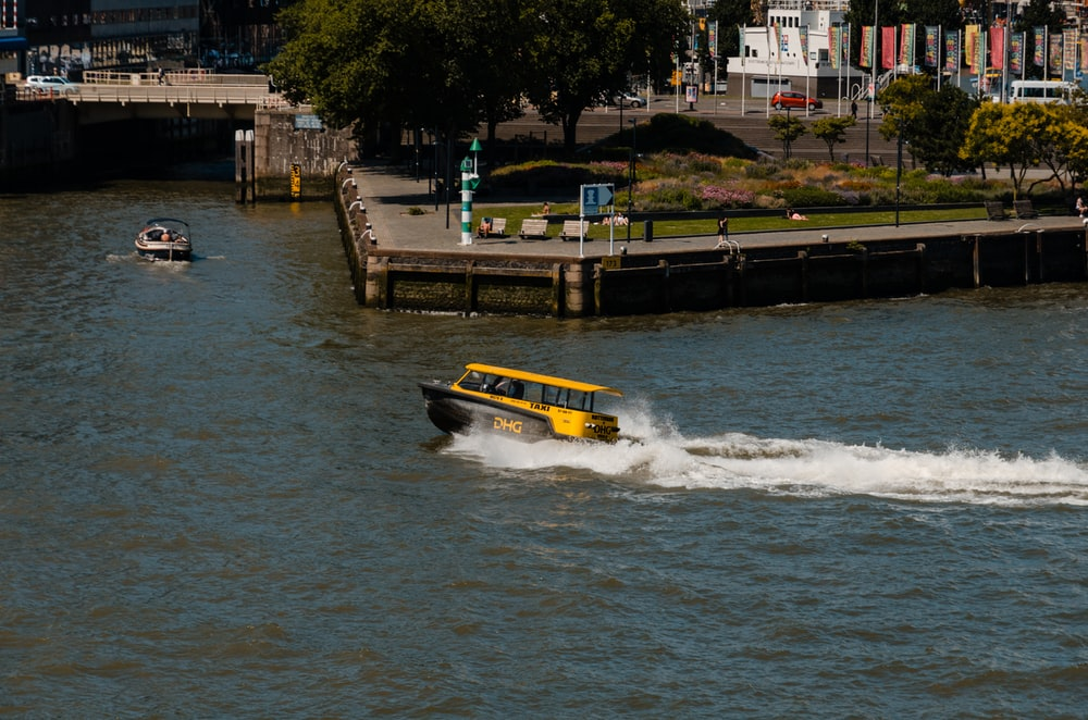 yellow and black boat on body of water