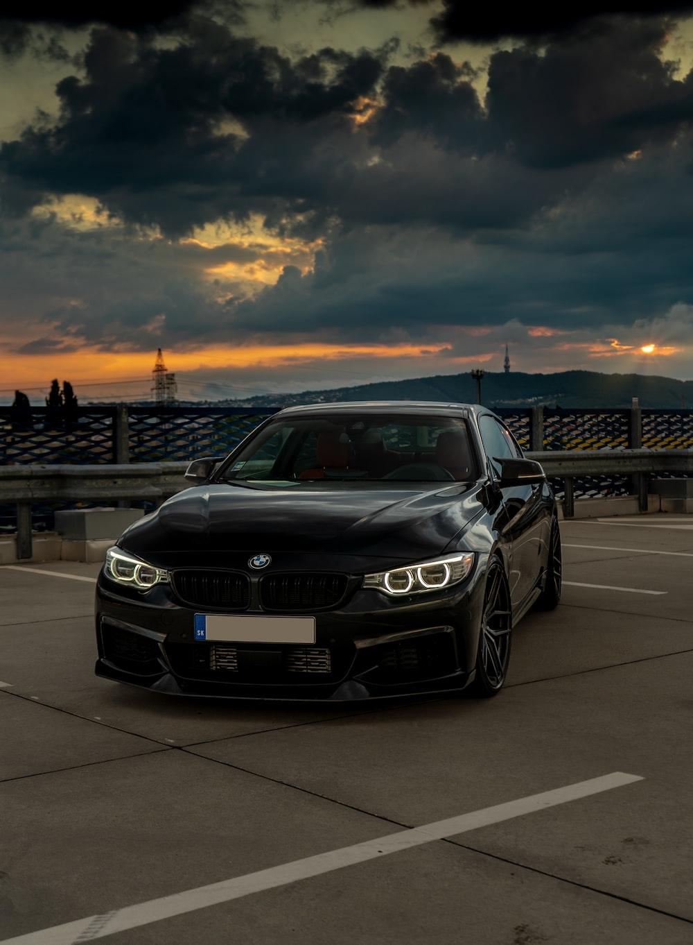 black vehicle under grey clouds