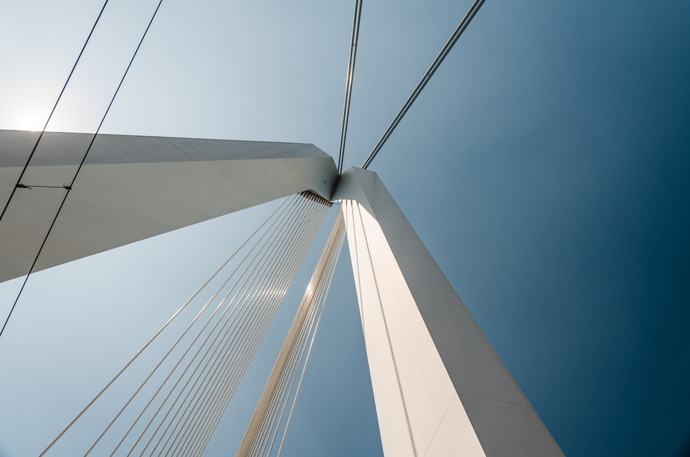 low-angle photography of suspension bridge
