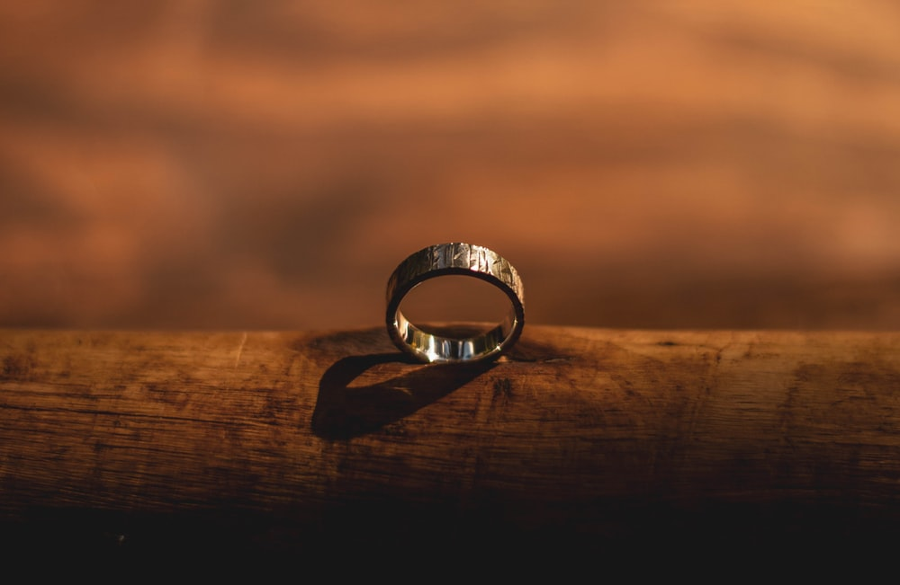 shallow focus photography of gold-colored ring