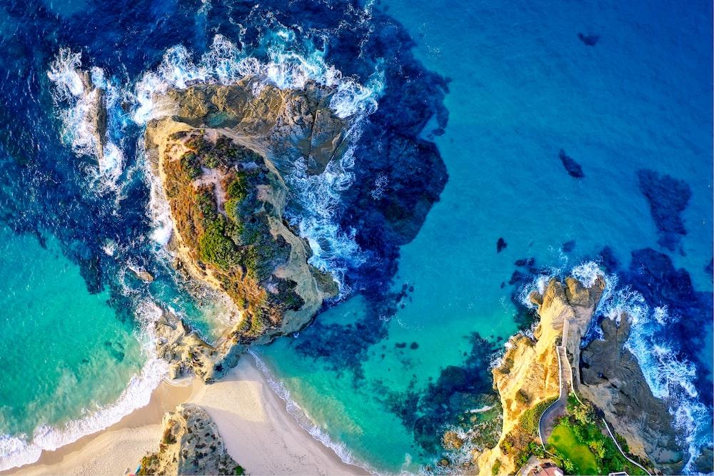 aerial photography of island beside sea