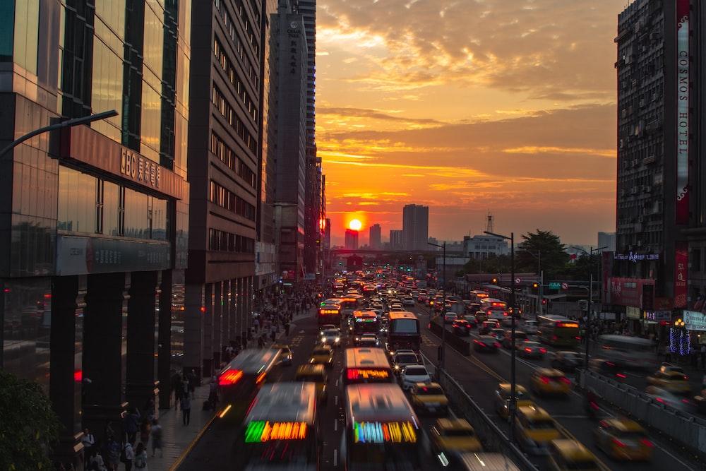 vehicles on road beside buildings