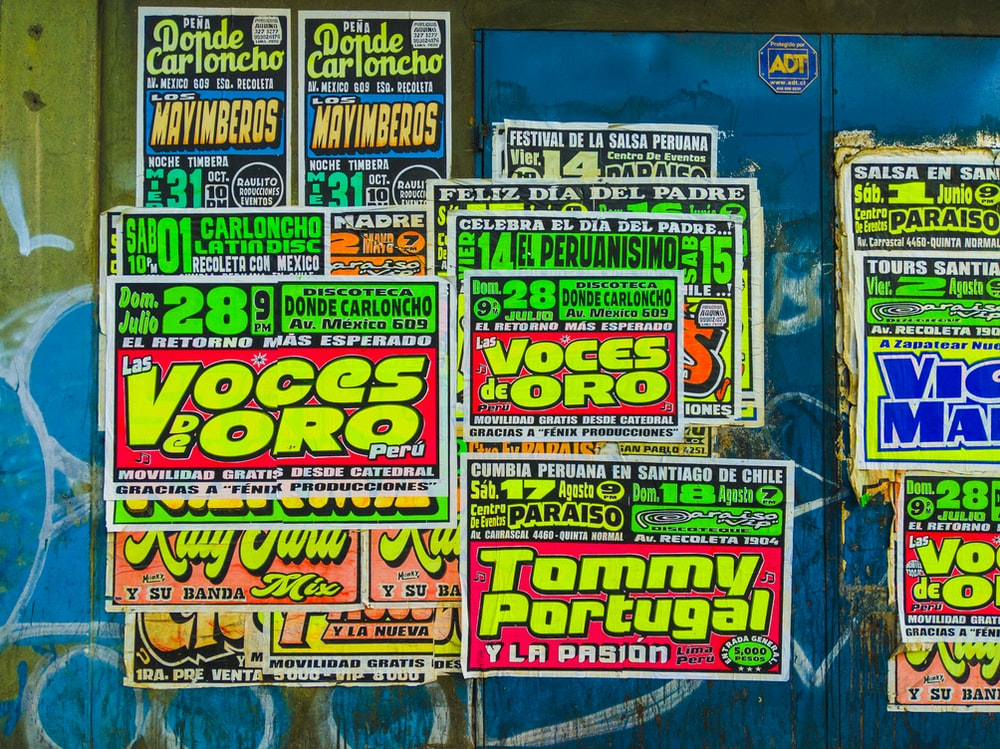 assorted posters on mural wall