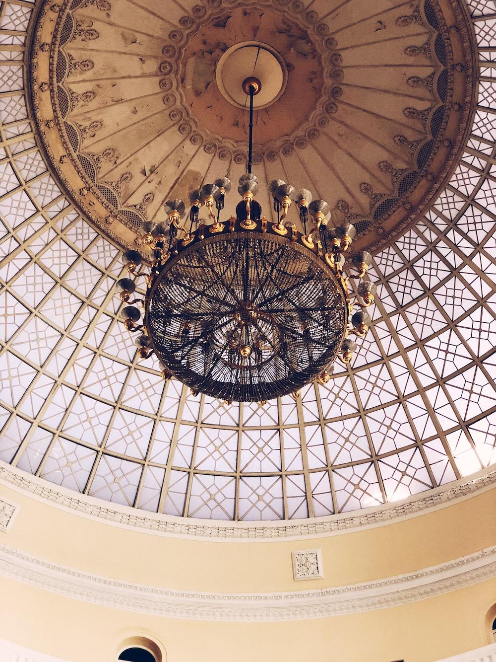 brass-colored uplight chandelier