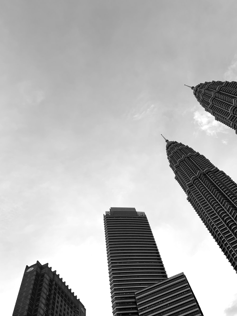 low angle photo of four highrise buildings