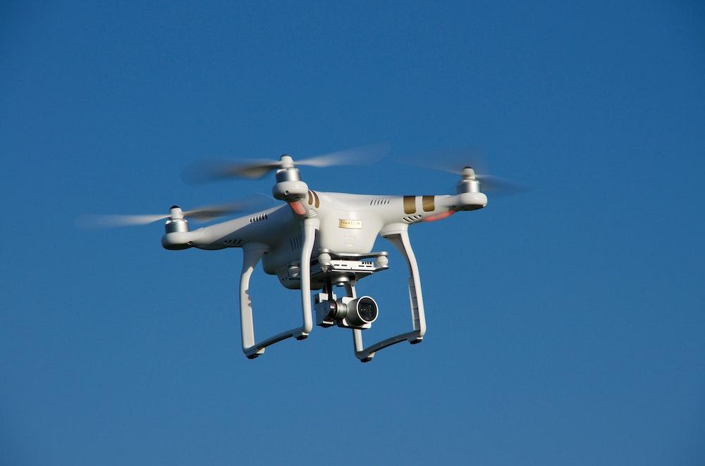 turned-on DJI Phantom quadcopter drone