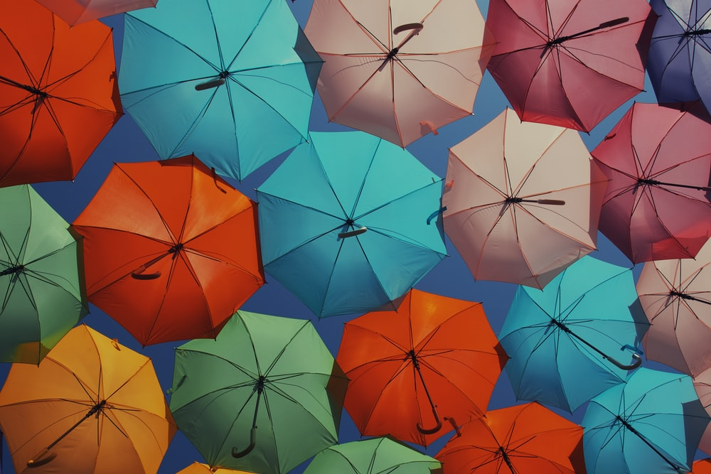 bunch of assorted-color umbrellas