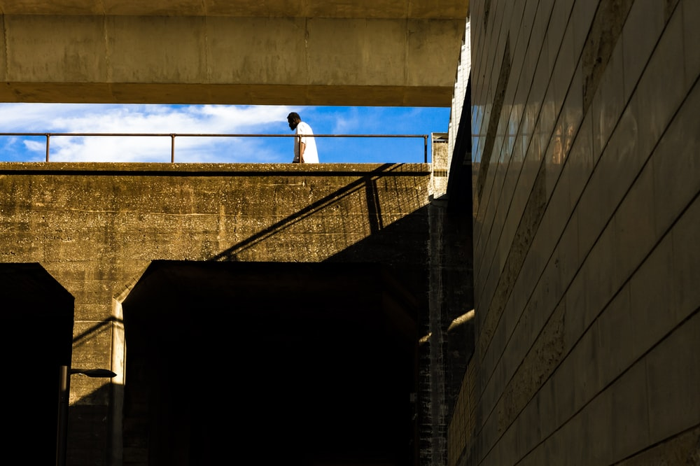 man walking on roof of building during day