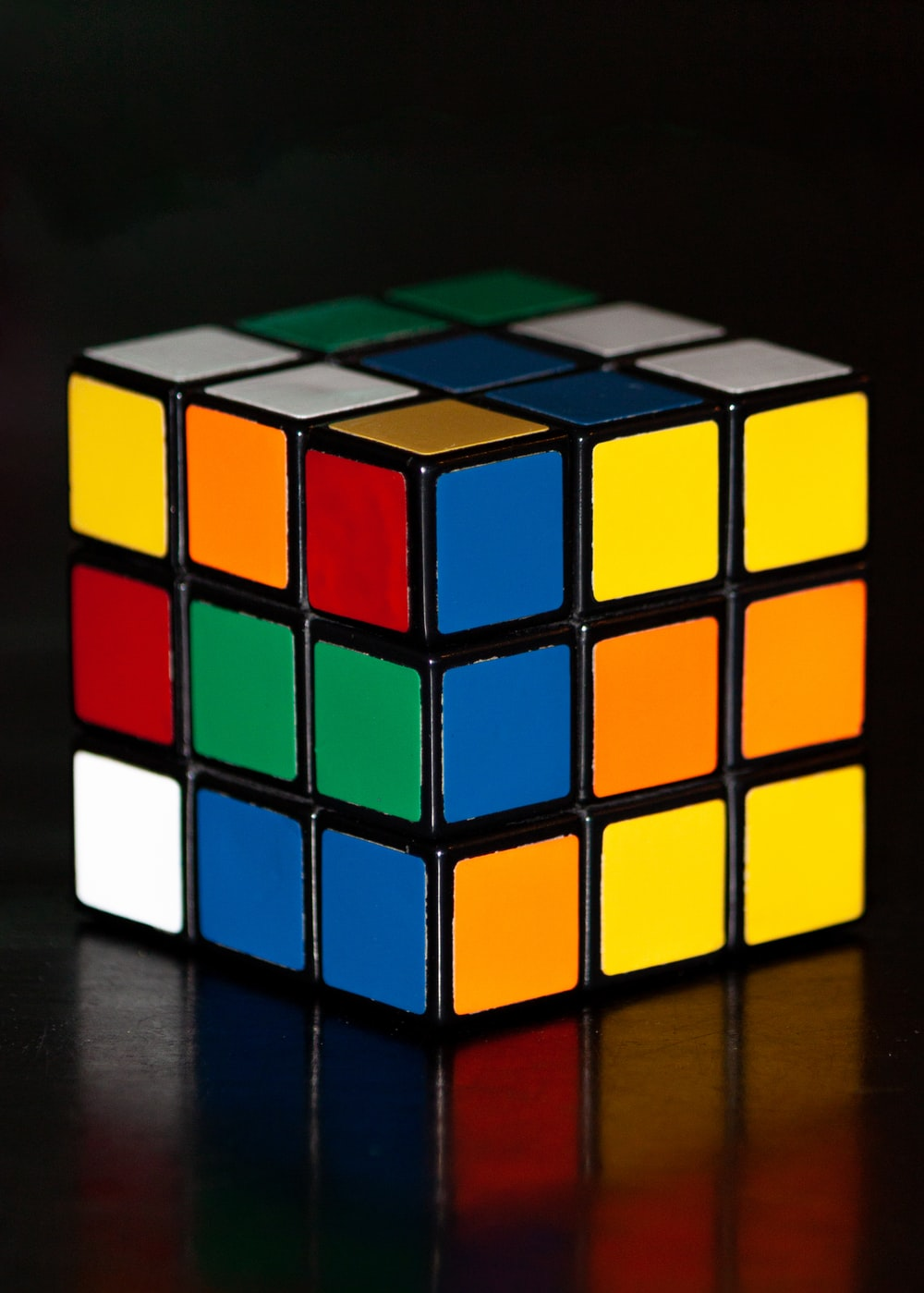 3 x 3 Rubik's Cube on black surface