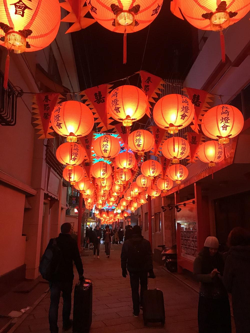 Chinese lanterns hung above people
