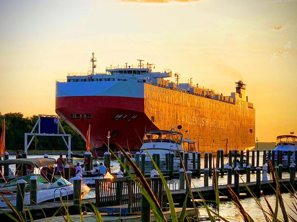 ship on dock during golden hour