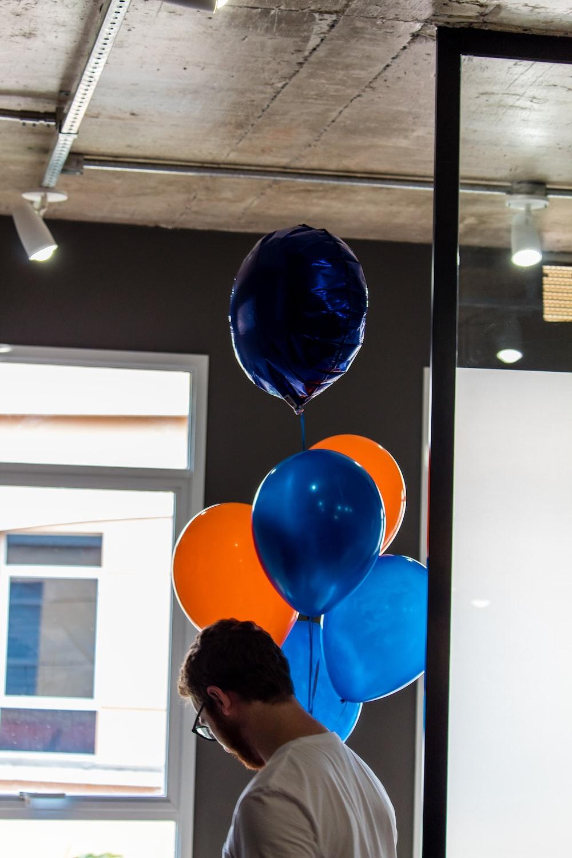 person standing near balloon