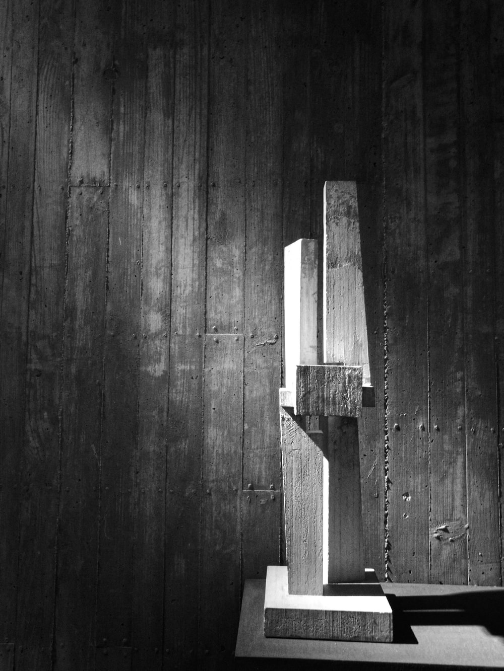 grayscale photo of wood slab decor