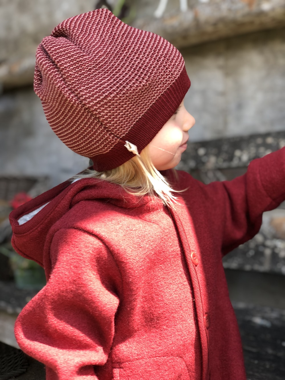 girl wearing red jacket