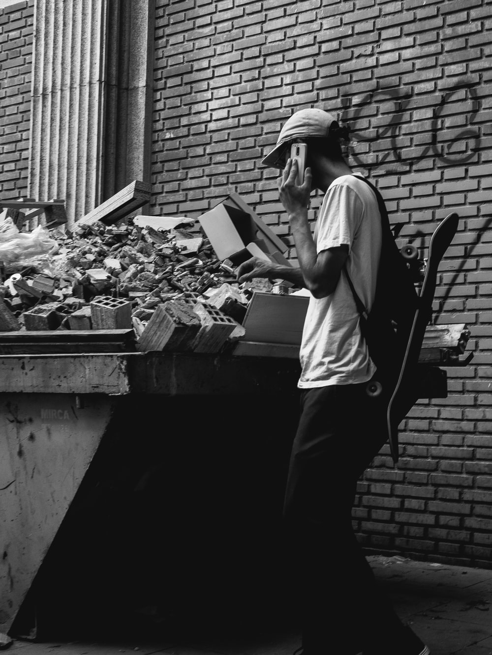 grayscale photo of person using Android smartphone