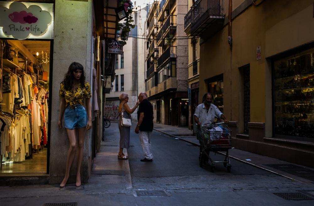 people walking near store beside buildings