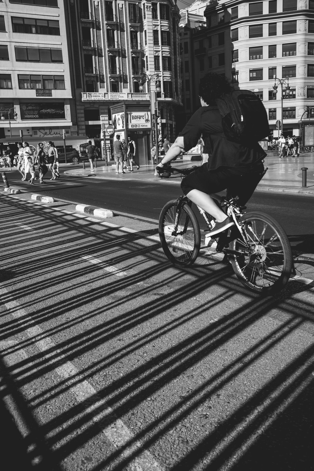 person riding bicycle on street