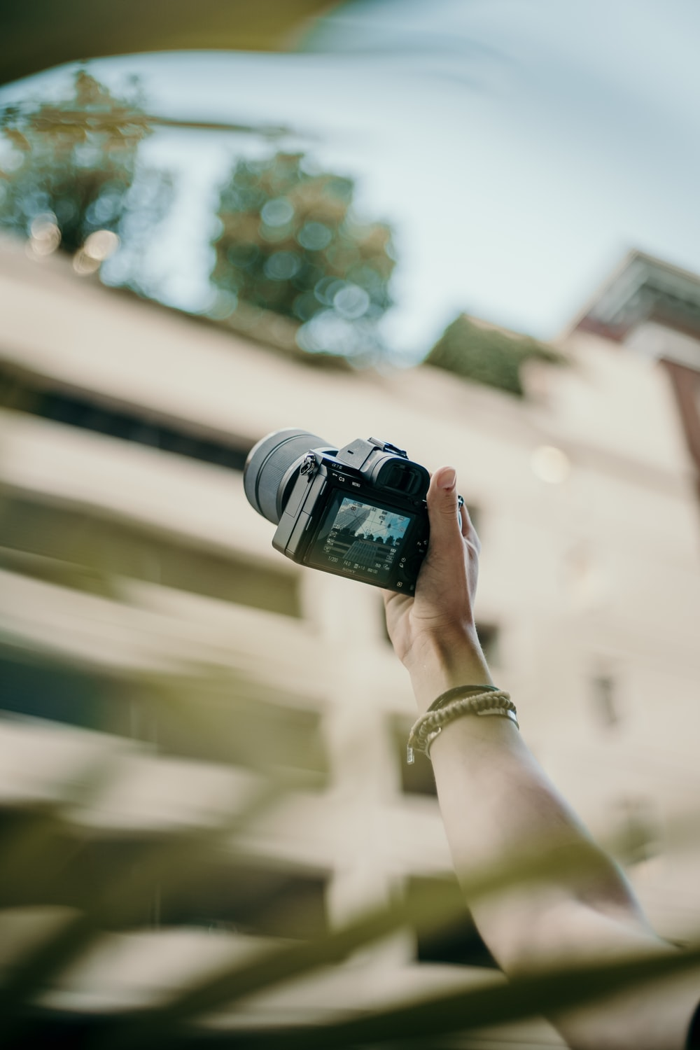 selective focus photography of holding black camera