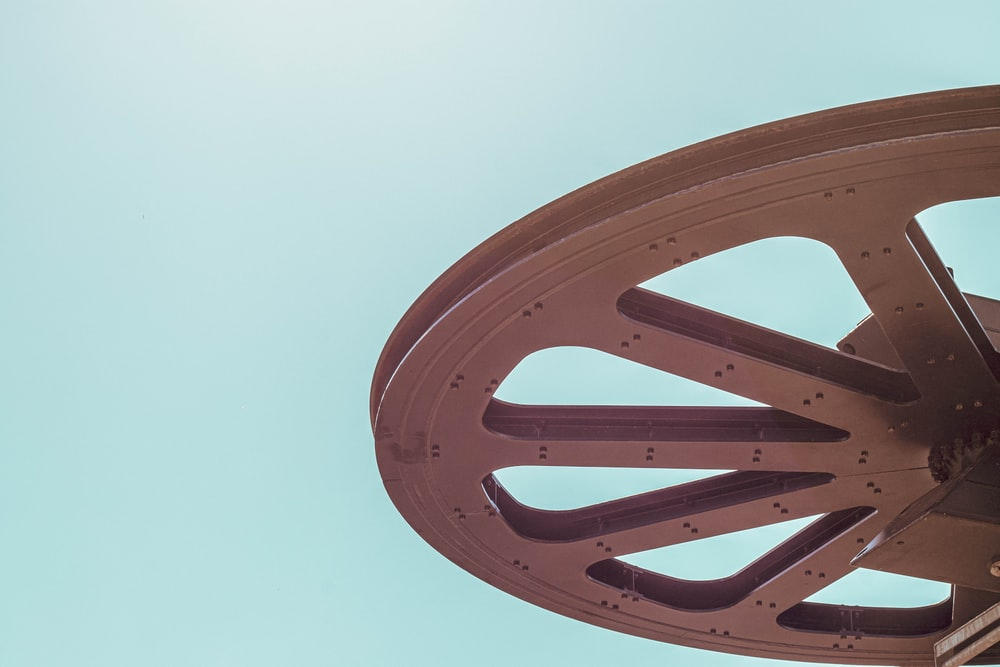 round brown carriage wheel