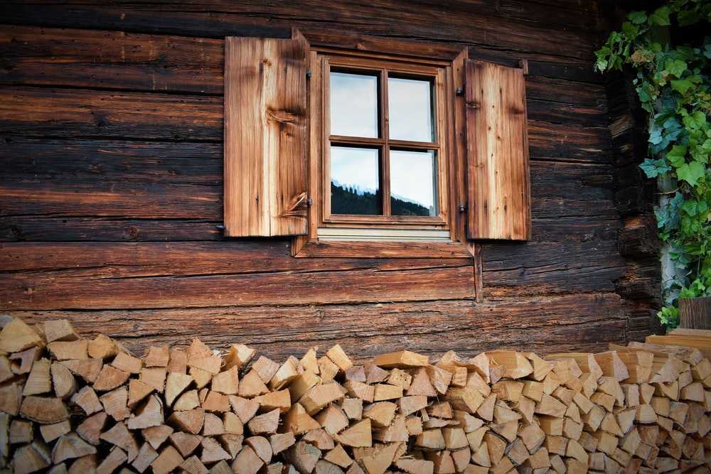 brown wooden casement window panel on brown house