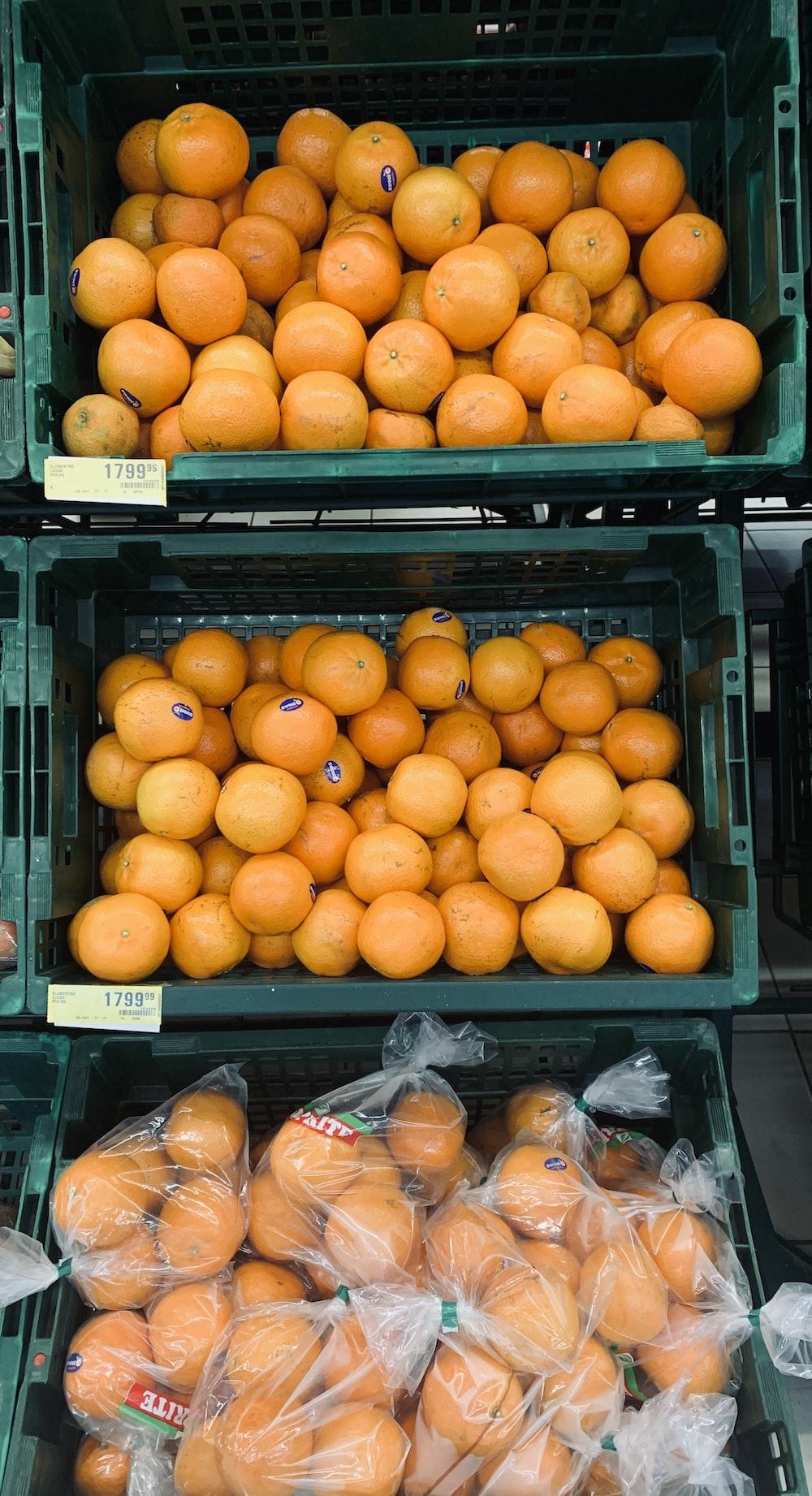 three baskets of oranges