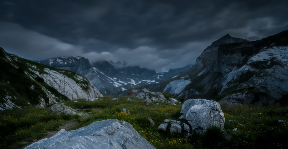 aerial photography of mountains under dramatic sky