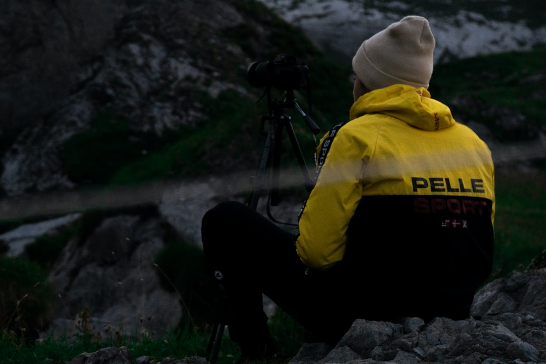 A photographer is waiting for the perfect shot
