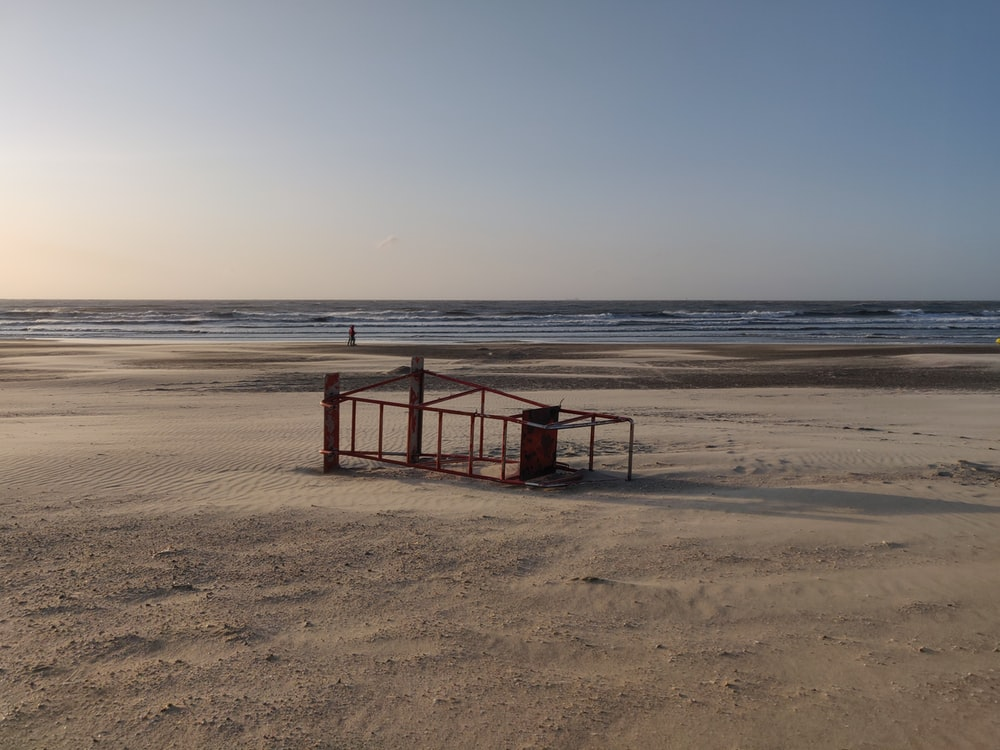 lifeguard tower on it's side on seashore