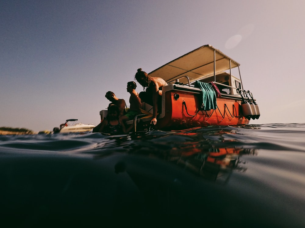 people in boat on sea