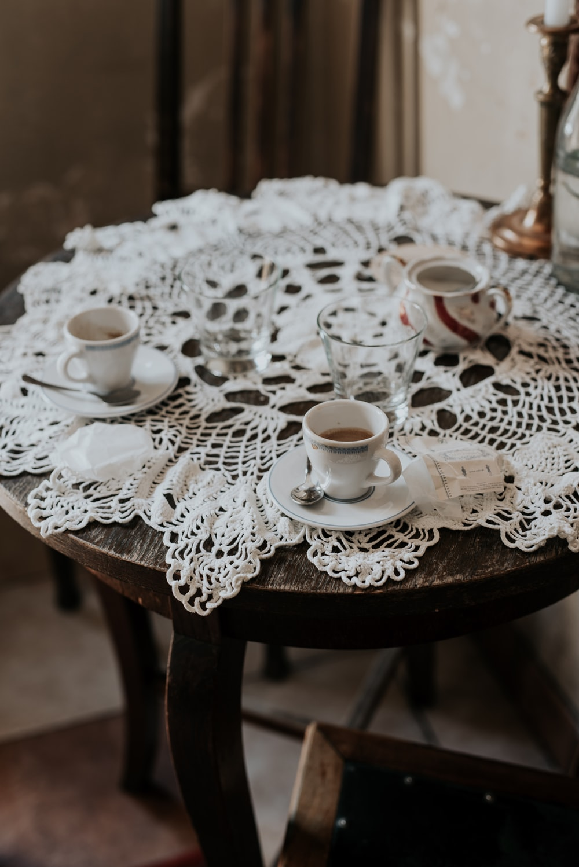 three white ceramic coffee cups