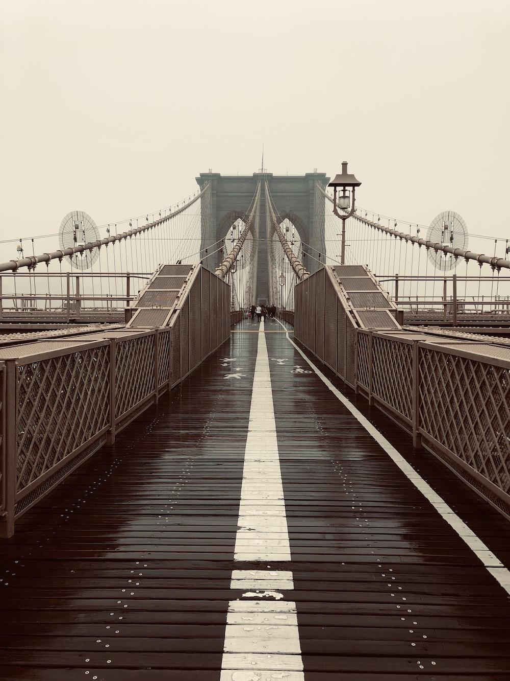 Brooklyn Bridge under gray sky