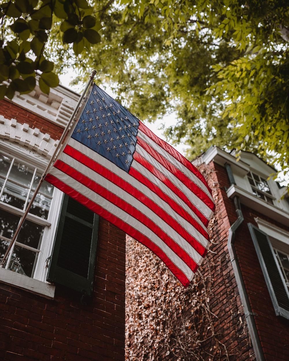 us a flag on brown brick wall