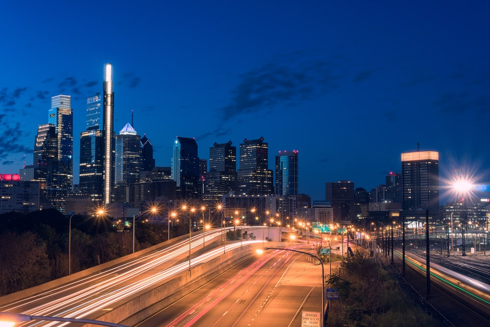 timelapse photography of street and high-rise buildings
