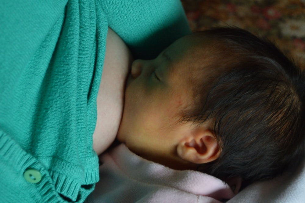 baby breastfeeding during daytime