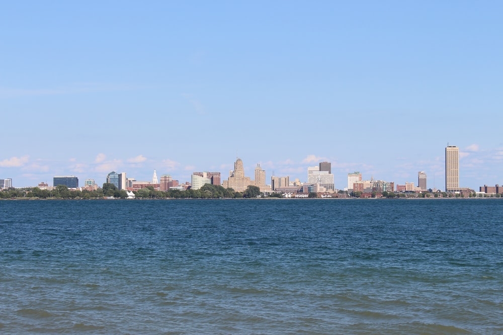 city buildings behind body of water during daytime