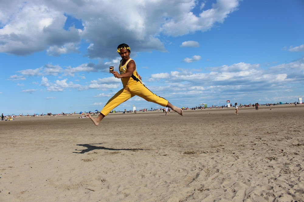person wearing yellow jumpsuit