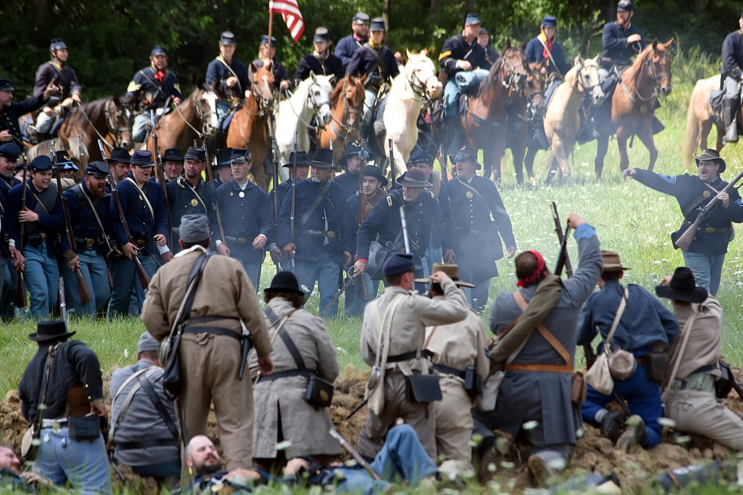 Union infantry and calvary advancing on Confederate line. Civil war reeanactment.
