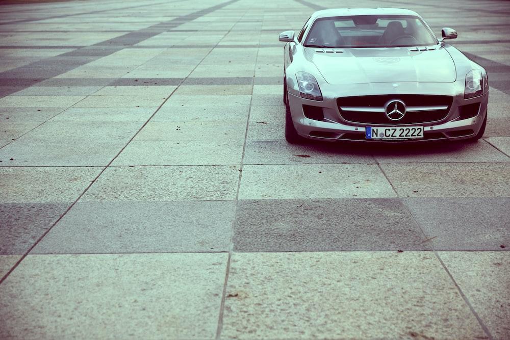 silver Mercedes-Benz SLR- coupe