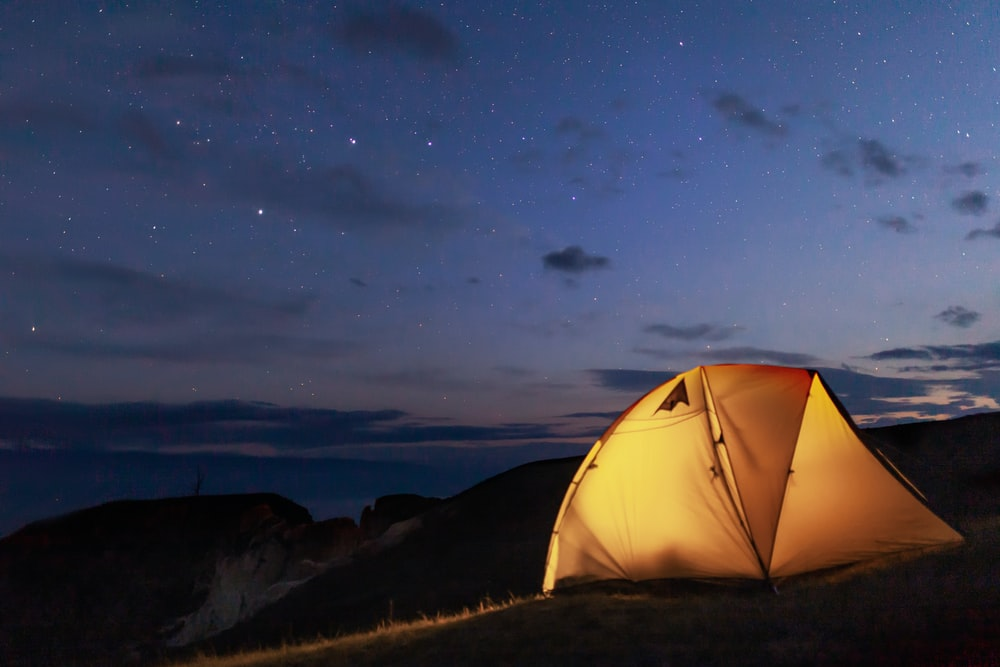 dome tent on mountain at night