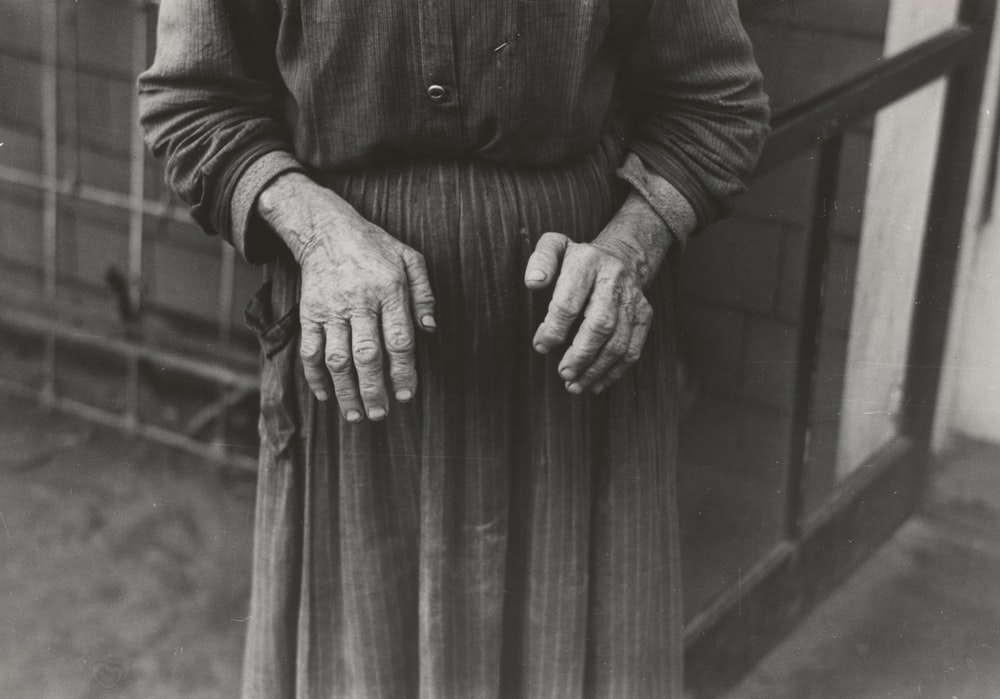 grayscale photography of woman wearing long-sleeved maxi dress