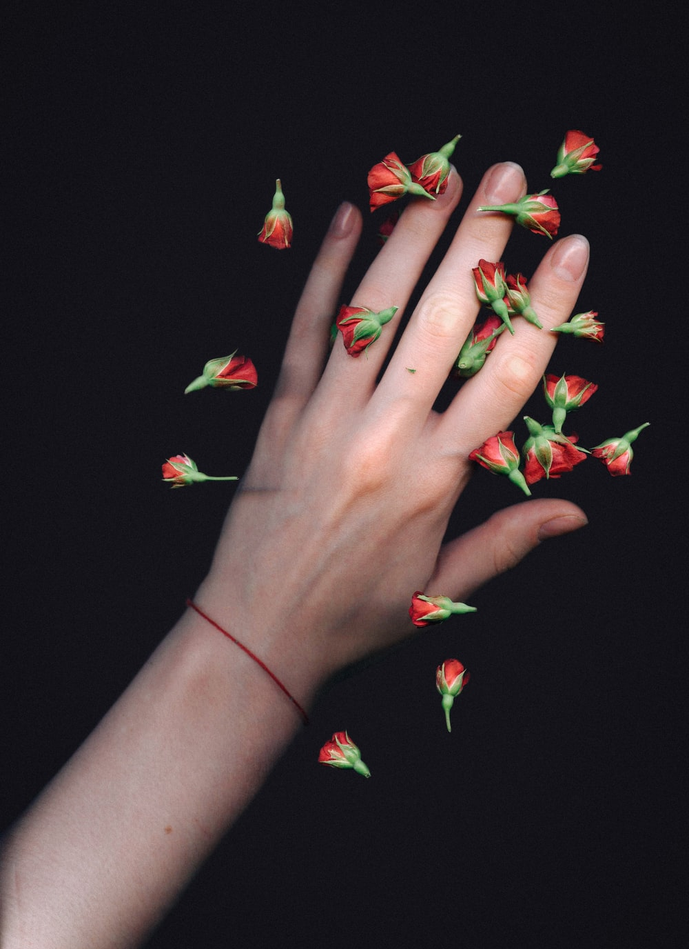 left hand with red flowers