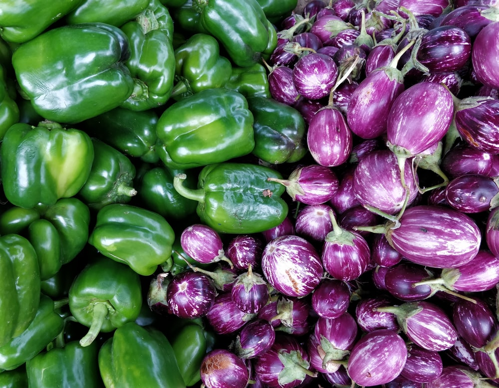 green bell peppers and purple eggplants