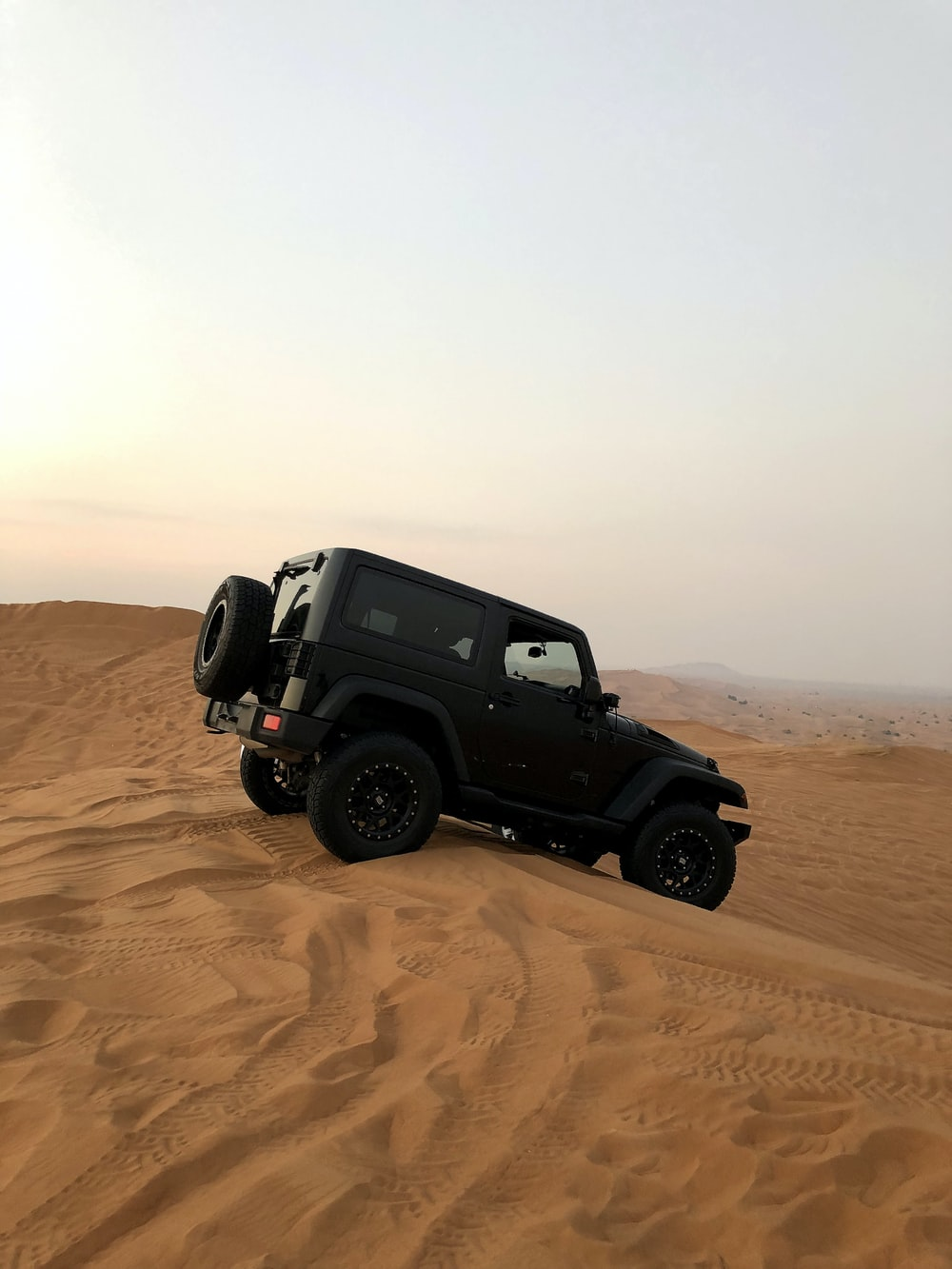 black Jeep Wrangler on desert