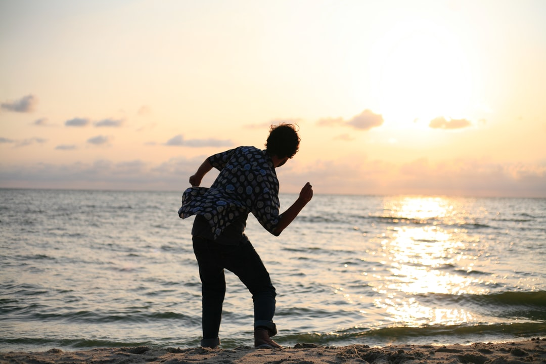 Skipping stones at sunset