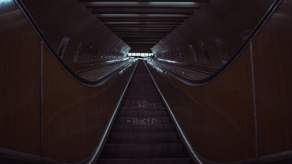 brown escalator with no people